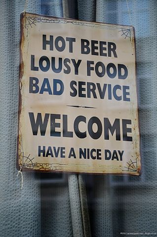 318px-hot_beer_lousy_food_bad_service_-_welcome_have_a_nice_day_sign_in_antwerp_belgium